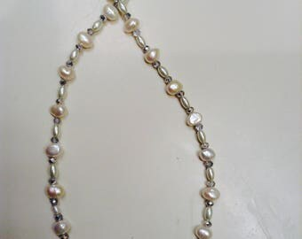 Necklace:    White Fresh Water Pearls with clear crystal spacers