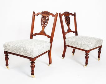 A pair of antique nursing chairs
