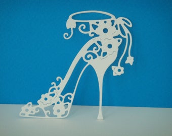 Cutting white shoe heel with small flowers for scrapbooking and card