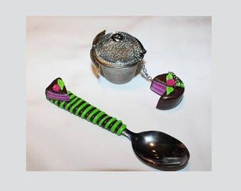 Filter tea and teaspoon gourmet cake chocolate raspberry