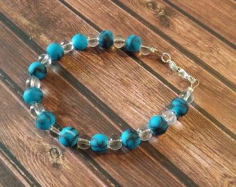 Bracelet couleur turquoise et transparente en perles de verre