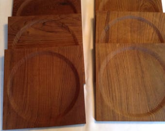 Teak dinner plate chargers from India