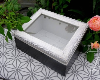 Box display, with a frame, weathered gray and white