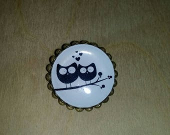 OWL brooch with lace cabochon.
