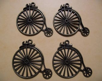 1 large charm / pendant bike bronze color. 4.6 cm x 5 cm.
