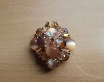 Brown ring and peach swarovski Pearl.