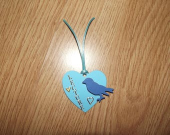 Small bookmark blue with a bird.