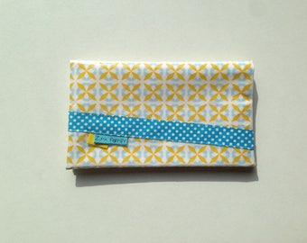 Checkbook holder in white oilcloth patterned turquoise and yellow geometric