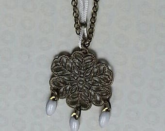 Necklace mid-length bronze engraving and shuttles white