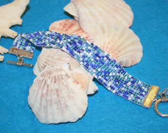 Bracelet woven with blue seed beads