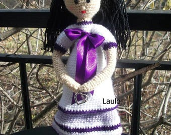 doll in white and purple wool with a small heart jewelry