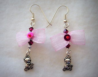 Earrings cat on bike with pink bow and Swarovski crystals for pierced ears