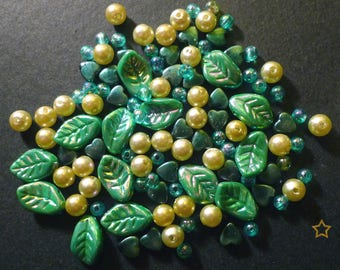 115 mixed green synthetic beads