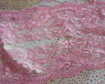 Pink floral fine openwork lace slightly elastic polyester 6,00 cm wide.