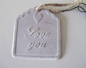 "tag metal with inscription ""Love you"" with cord"