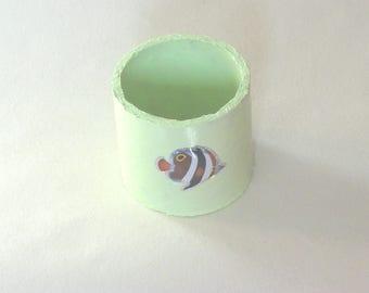 Green towel round cardboard roll, fish