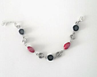 Mother of pearl bracelet red and black beads.