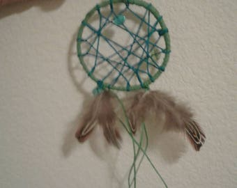 Neon blue and green dreamcatcher