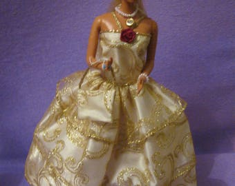 Dress has white background (B70) Gold ruffles