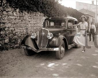 An old photo print. 1930's car Peugeot 301 woman portrait