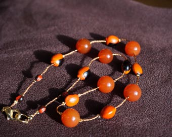 Necklace with carnelian and red and black inside