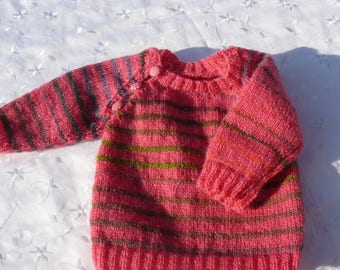 Pink and multicolored striped baby sweater