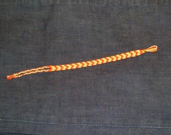 Lens bracelet red and yellow chevron