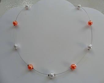 Bridal white pearls and orange jewels ceremony