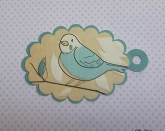 Green embossed bird tag
