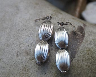 Silver earrings made of two oval beads