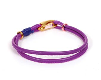 Bracelet cord have purple to personalize it with beads - jewelry Creations.