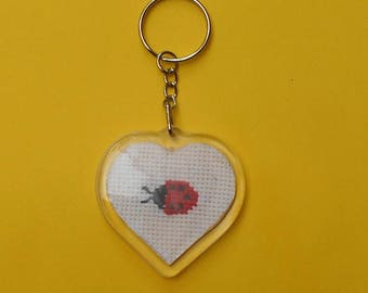 Heart shaped key chain with a ladybug