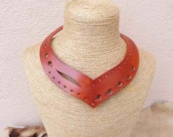 The Choker necklace orange asymmetrical perforated leather