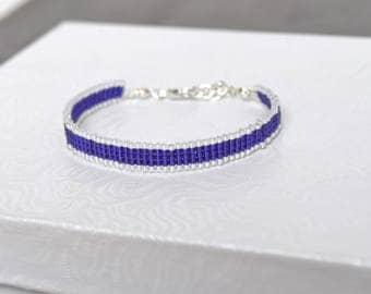 Bracelet woven with Miyuki Delica bright purple and silvery white