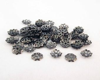 set of 50 bead caps, gun black caps