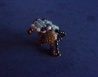 Blue tit in multicolored seed beads - 40mm x 20mm