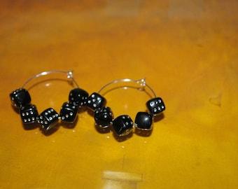 Pair of hoop earrings made of acrylic beads