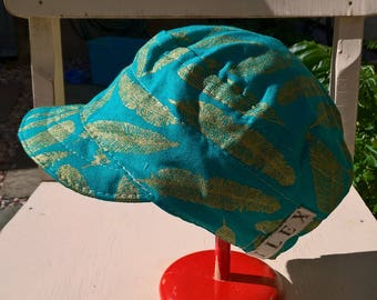 golden feathers cap