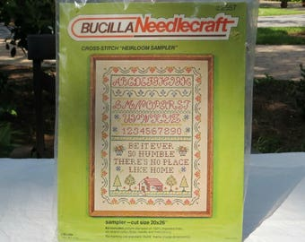 Bucilla Needlecraft Stamped Cross-Stitch Heirloom Sampler | Log Cabin | Be It Ever So Humble There's No Place Like Home | Craft Kit #2557