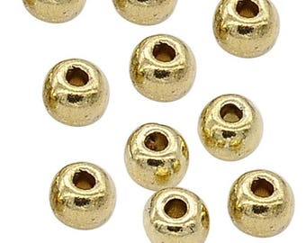 x 10 round beads 4 mm gold tone.