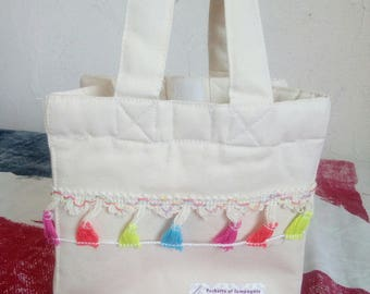 small bag with tassels flashy