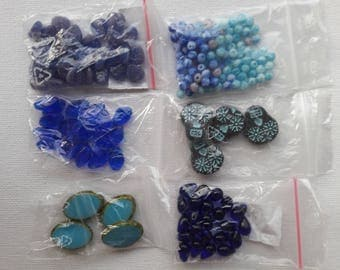 Set of 6 bags of beads blue.