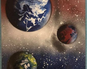 Spray Paint Art - Three Planet System with a Red, White, and Blue Cloud System