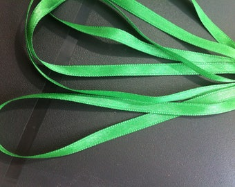 1 m of 6mm green colored satin ribbon