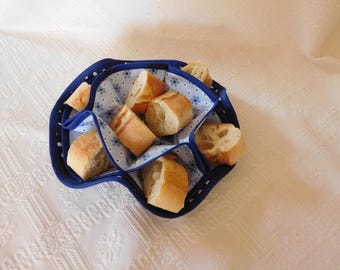 basket has breads or tidy flower shape.