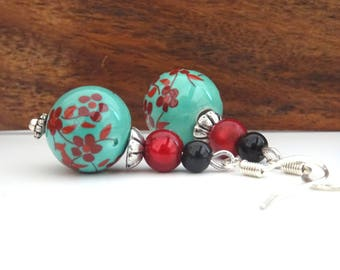 Red cherry blossoms and green dangle earrings