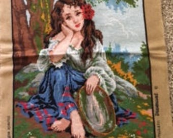 Needlepoint picture of girl and banjo