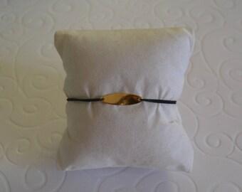 Bracelet on cord and tassel twist olive gold