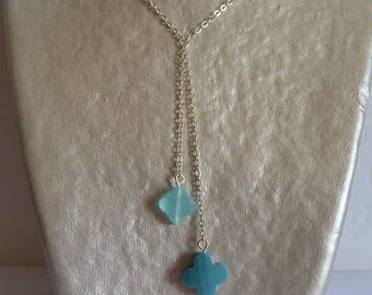 Double Blue clover suspended on silver chain necklace