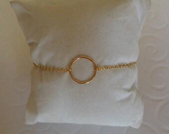 Circle bracelet on gold chain